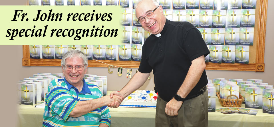 Fr. John receives special recognition from Fr. Andy Knop, OMI