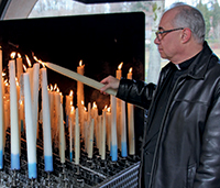 Fr. Andy lighting candles