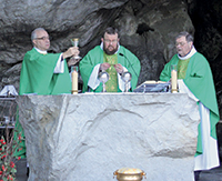 Fr. Andy saying Mass at the Sacred Grotto in Lourdes, France