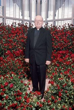 Fr. Clark amidst roses